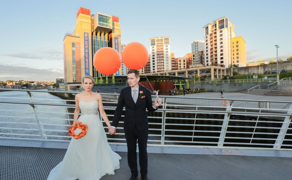 Contemporary Cool Wedding photography at The Baltic Newcastle- Vintage Large Balloons & Orange Flowers in Mason Jars
